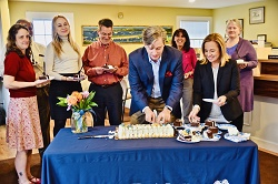 MVB President & CEO James Anthony and employees cut the cake